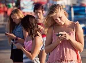 3776452-serious-teenagers-on-smartphones